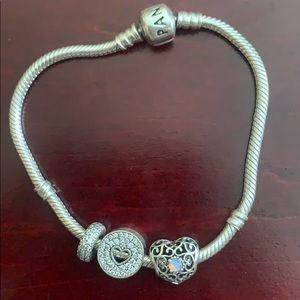 Pandora Bracelet with three charms!